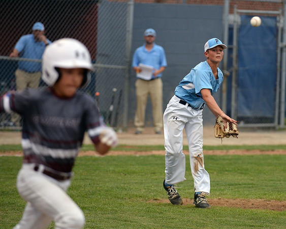 RYAN HUTTON/ Staff photo<br /> Peabody pitcher Carson Browne fires the ball to first to beat Gloucester's Jared Healey during the top of the fourth inning of Saturday night's  Section 4 Little League championship at Wyoma Field.