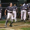 HADLEY GREEN/ Staff photo<br /> Gloucester catcher Max Viera (25) celebrates after his teammate scores at the Beverly v. Gloucester District Finals Little League game. 7/14/17
