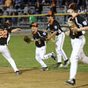 HADLEY GREEN/ Staff photo<br /> Beverly's Noah Guanci (7) celebrates with his team after making a catch in the outfield at the Beverly v. Gloucester District Finals Little League game. 7/14/17