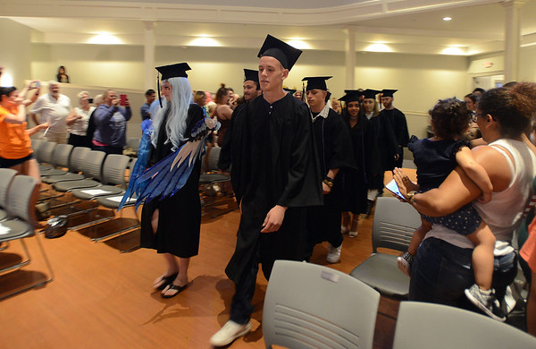 RYAN HUTTON/ Staff photo<br /> The New Liberty Innovation School Class of 2017 process into the Salem YMCA's Ames Hall for the start of their graduation ceremony on Thursday.