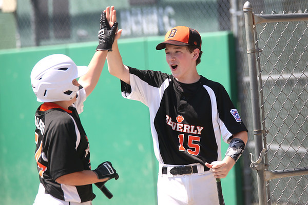 HADLEY GREEN/ Staff photo<br /> Beverly's Ian Visnick (15) high-fives teammate Max Salerno (54) at the Beverly v. Hamilton-Wenham little league playoff game at the Harry Ball Field in Beverly. 7/08/17