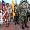 HADLEY GREEN/Staff photo<br /> Veterans stand with flags at the ribbon cutting ceremony for the new Vietnam Veterans Memorial Plaza at One Ellis Square in downtown Beverly. 7/28/17