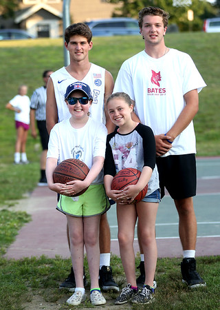HADLEY GREEN/Staff photo<br /> Sophia Smith, left, and her sister, Annabelle Smith, hold signed basketballs at the Arms Around Sophia 3 on 3 basketball tournament. Behind them are Billy Ackerman, left, and Derek Marino, right, two Marblehead High basketball players who planned the fundraiser. 8/01/17