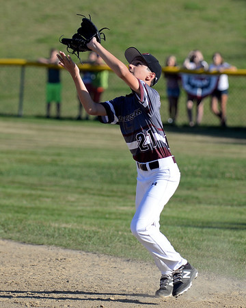 RYAN HUTTON/ Staff photo<br /> Gloucester's Drew Macchi moves to catch a fly ball during the bottom of the second inning of Wednesday's game against Danvers at Boudreau Field in Gloucester.