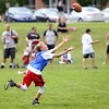 HADLEY GREEN/Staff photo<br /> Max Cramer runs to catch a football thrown by Patriots wide receiver Julian Edelman at the Julian Edelman Football Clinic at Danvers High School. 7/15/17