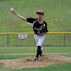 TIM JEAN/Staff photo<br /> Beverly's Cooper Garvin throws a pitch against Gloucester during the District 15 Williamsport Little League Baseball Tournament game. Gloucester defeated Beverly 10-8. 7/1/17