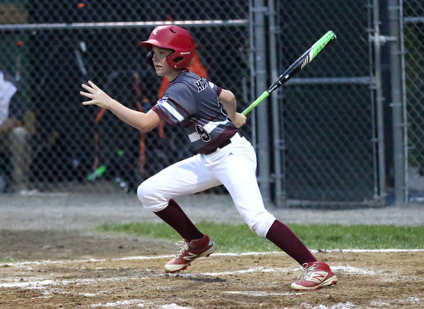 HADLEY GREEN/ Staff photo<br /> Gloucester's Carson Harwood (9) hits at the Beverly v. Gloucester District Finals Little League game. 7/14/17