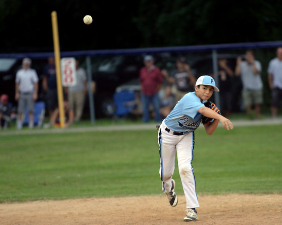 RYAN HUTTON/ Staff photo<br /> Peabody's Robert Galvin fires the ball to first during the top of the fourth inning of Saturday night's Section 4 Little League championship against Gloucester at Wyoma Field.