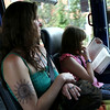 HADLEY GREEN/Staff photo<br /> Ara MacDonald and her daughter, Oriana Steele, ride the Newburyport Rockport line shuttle bus from the Salem MBTA Station to Rockport. 7/18/17