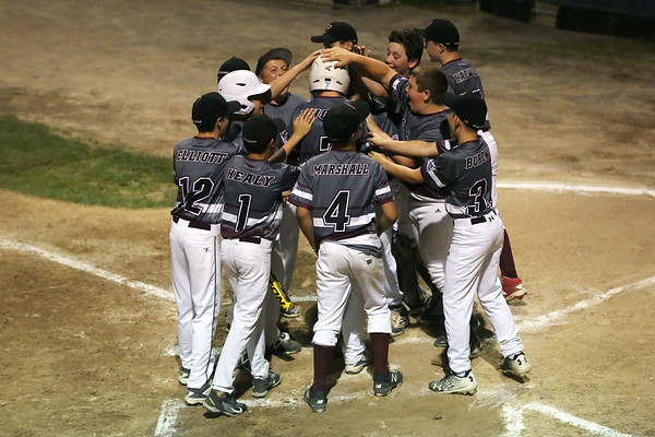 HADLEY GREEN/Staff photo<br /> Gloucester players congratulate Jared Lucido (7) on his home run at the Peabody West Little League all-stars' game vs. Gloucester at the Reinfuss Field in Lynn. 7/19/17