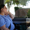 HADLEY GREEN/Staff photo<br /> Sandra Lawson of Gloucester rides to Beverly for work on the MBTA Newburyport Rockport line shuttle bus. 7/18/17