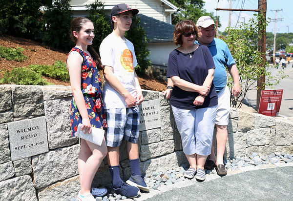 HADLEY GREEN/Staff photo<br /> From left, Faith Wardwell, Jared Wardwell, Gerry Wardwell,  and Carla DeLuca-Wardwell stand in front of Samuel Wardell's plaque. Samuel Wardell is the ninth great grandfather of Gerry Wardwell was one of the 19 innocent people hanged in 1692 for the supposed crime of witchcraft. 7/18/17