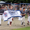 RYAN HUTTON/ Staff photo<br /> Gloucester celebrates winning Saturday night's Section 4 Little League championship against Peabody at Wyoma Field 10-0 in four innings.