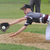 TIM JEAN/Staff photo<br /> Gloucester pitcher Jarred Lucido dives and scoops up the ground ball and throws out the Beverly batter during the District 15 Williamsport Little League Baseball Tournament game. Gloucester defeated Beverly 10-8. 7/1/17