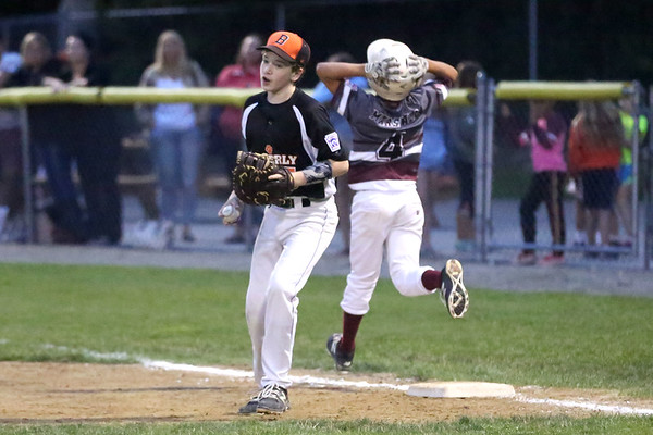 HADLEY GREEN/ Staff photo<br /> Beverly's Ian Visnick (15) tags Gloucester's Emerson Marshall (4) out at first at the Beverly v. Gloucester District Finals Little League game. 7/14/17