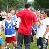 HADLEY GREEN/Staff photo<br /> Patriots wide receiver Julian Edelman high fives players at the Julian Edelman Football Clinic at Danvers High School. 7/15/17