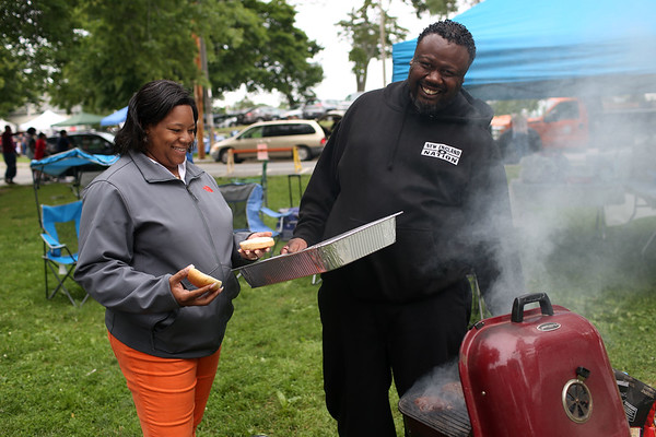HADLEY GREEN/Staff photo<br /> From left, Stacy and Dwayne Wheeler grill burgers at the Salem Willows Black Picnic. Dwayne has come to the picnic for forty years. 7/15/17
