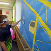"RYAN HUTTON/ Staff photo<br /> Jacob Diefenbach, 9, plays a game of ""pin the hook on the crane"" at the Salem Public Library's kid's summer reading program kick off party on Wednesday."