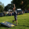 HADLEY GREEN/Staff photo<br /> Joshua Sanchez, 8, of Peabody, plays cornhole at the Salem National Night Out on the Salem Common. 8/01/17