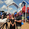 RYAN HUTTON/ Staff photo<br /> Dennis and Erin O'Donnell give an interview during the opening of the playground at the South Memorial School in Peabody named in they daughter Ella Jade's honor on Wednesday.