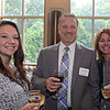 RYAN HUTTON/ Staff photo<br /> From left, Sarah Slavin, from Davio's Northern Italian Steakhouse, Thomas Streep, of Edward Jones Investments, and Gia Page, from Davio's, at the North Shore Chamber of Commerce's After Hours event at the Wylie Inn and Conference Center on Thursday.