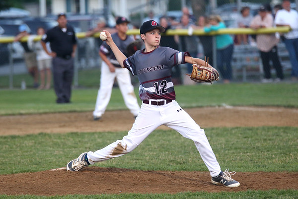 HADLEY GREEN/ Staff photo<br /> Gloucester pitcher Tommy Elliott (12) prepares to throw the ball at the Hamilton-Wenham v. Gloucester Little League tournament game at the Harry Ball Field in Beverly. 7/11/17