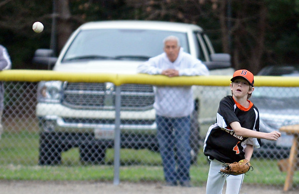 RYAN HUTTON/ Staff photo<br /> Beverly's Dylan Crowley fires the ball in from left field during the top of the first inning of Thursday's District 15 Little League Final game against Gloucester at Harry Ball Field in Beverly on Thursday.