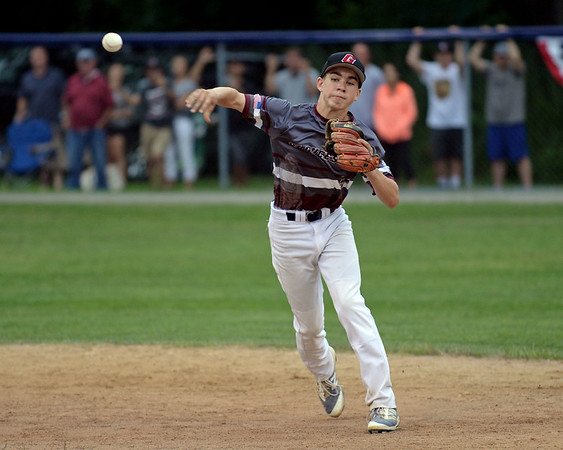 RYAN HUTTON/ Staff photo<br /> Gloucester's Jared Lucido fires the ball to first during the bottom of the first inning of Saturday night's Section 4 Little League championship against Peabody at Wyoma Field.
