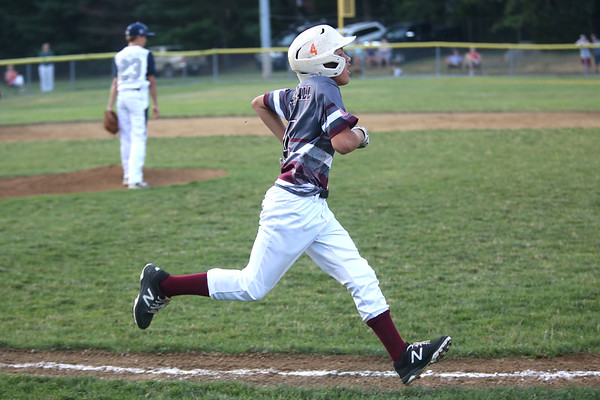 HADLEY GREEN/ Staff photo<br /> Gloucester's Emerson Marshall (4) runs to first base at the Hamilton-Wenham v. Gloucester Little League tournament game at the Harry Ball Field in Beverly. 7/11/17