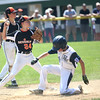 HADLEY GREEN/ Staff photo<br /> Beverly's Sam Armbruster (24) tags Hamilton-Wenham's Connor McClintock (23) out at second base at the Beverly v. Hamilton-Wenham little league playoff game at the Harry Ball Field in Beverly. 7/08/17
