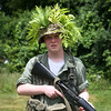 HADLEY GREEN/Staff photo<br /> Finn Arsenault tries his best to blend in at Military Day on the Patton Homestead in South Hamilton. Arsenault is part of the Living History Association, a historical reenactment group in New England. 7/15/17