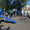 RYAN HUTTON/ Staff photo<br /> Kids play on a new piece of playground equipment during the grand re-opening of the Mary Jane Lee Park in the Point in Salem on Wednesday.