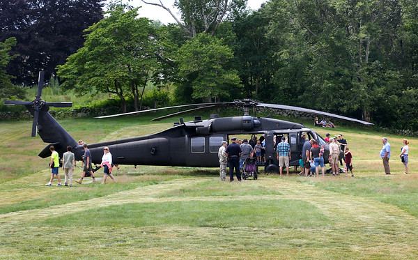 HADLEY GREEN/Staff photo<br /> People explore a Black Hawk helicopter at Military Day at Patton Homestead in South Hamilton. 7/15/17