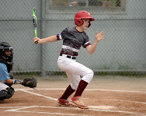 RYAN HUTTON/ Staff photo<br /> Gloucester's Carson Harwood watches the ball he just hit fly during the top of the third inning of Saturday night's Section 4 Little League championship against Peabody at Wyoma Field.