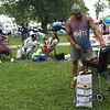HADLEY GREEN/Staff photo<br /> Elgin Bowden of Lowell barbecues for his family at the Salem Willows Black Picnic. 7/15/17