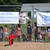 RYAN HUTTON/ Staff photo<br /> Children line up along the fence to await the opening of the  new playground at South Memorial School in Peabody on Wednesday. The playground is named in honor of Ella Jade O'Donnell, a local 10-year-old who died of brain cancer last year.