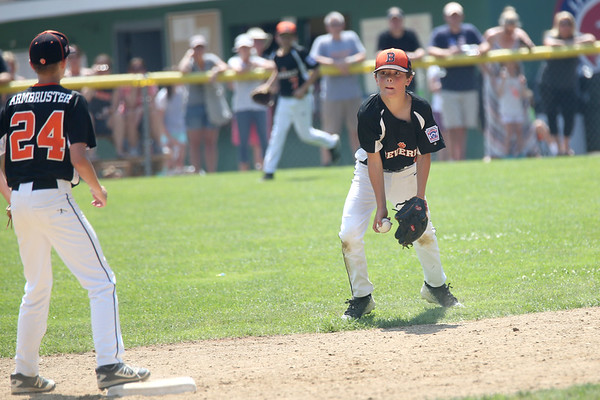 HADLEY GREEN/ Staff photo<br /> Beverly's Rook Landman (1) fields the ball and throws to short stop Sam Armbruster (24) the Beverly v. Hamilton-Wenham little league playoff game at the Harry Ball Field in Beverly. 7/08/17