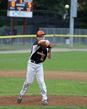 RYAN HUTTON/ Staff photo<br /> Beverly's Rydet Frost fires the ball to first to make the out during the top of the first inning of Thursday's District 15 Little League Final game against Gloucester at Harry Ball Field in Beverly on Thursday.