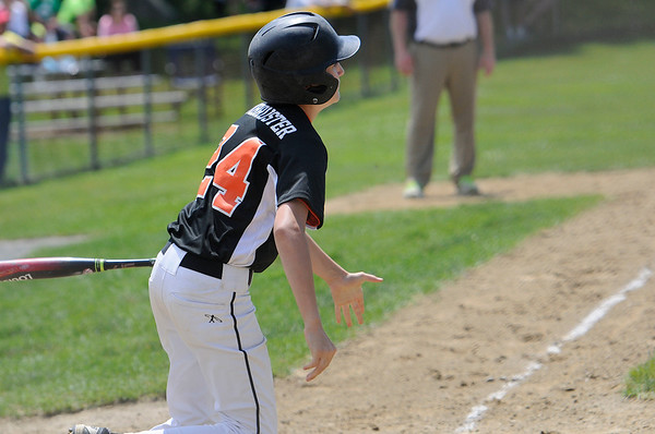 TIM JEAN/Staff photo<br /> Beverly's Sam Armbruster watches the ball land in the outfield for a hit against Gloucester during the District 15 Williamsport Little League Baseball Tournament game. Gloucester defeated Beverly 10-8. 7/1/17