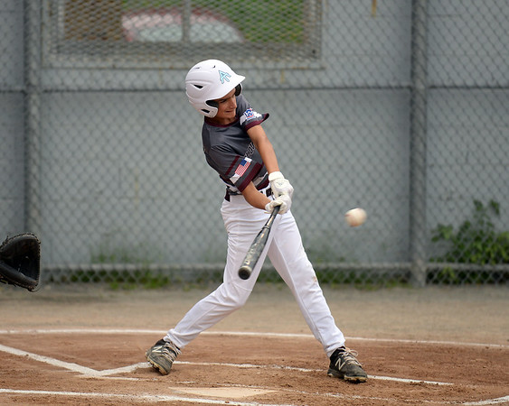 RYAN HUTTON/ Staff photo<br /> Gloucester's Drew Macchi swings away at an incoming pitch during the top of the first inning of Saturday night's Section 4 Little League championship against Peabody at Wyoma Field.