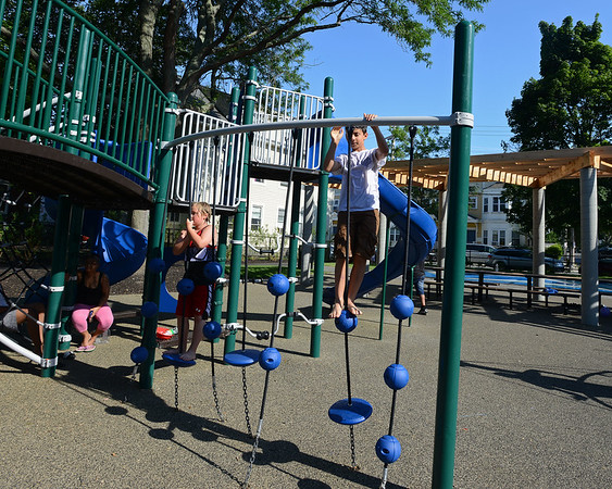 RYAN HUTTON/ Staff photo<br /> Jack Cederholm, 11, left, and Jacob Guarino, 11, climb the new playground equipment during the grand re-opening of the Mary Jane Lee Park in the Point in Salem on Wednesday.