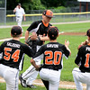 RYAN HUTTON/ Staff photo<br /> Beverly's Logan Petrosino high fives his teammates after finishing warmups before Thursday's District 15 Little League Final game against Gloucester at Harry Ball Field in Beverly on Thursday.