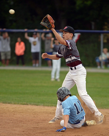 RYAN HUTTON/ Staff photo<br /> Gloucester's Jared Lucido raises his glove to snag the ball as Peabody's Cam Conolly slides in to second base during the bottom of the first inning of Saturday night's Section 4 Little League championship at Wyoma Field.