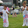 TIM JEAN/Staff photo<br /> Kairi Hislop, 6, left, races his sister Kymari, 4, in the sack races during the 3rd Annual Field Day and Scoop-Ah-Bowl party and Family Festival at Plains Park in Danvers. 7/1/17