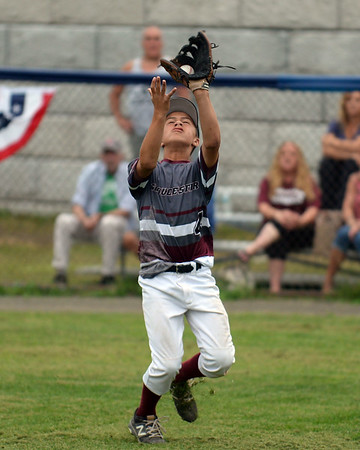 RYAN HUTTON/ Staff photo<br /> Gloucester's Emerson Marshall snags a fly ball for the out during the bottom of the first inning of Saturday night's Section 4 Little League championship against Peabody at Wyoma Field.