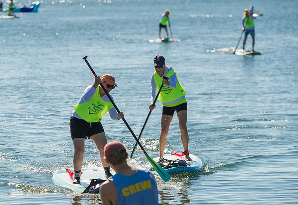 AMANDA SABGA/Staff photo<br /> <br /> From left Paula Kingsbury and Susan Fagan, both of Marblehead, race to the finish of a paddle board race during the 5th Annual Paddle for Plummer fundraiser for Plummer Youth Promise.<br /> <br /> 7/7/18