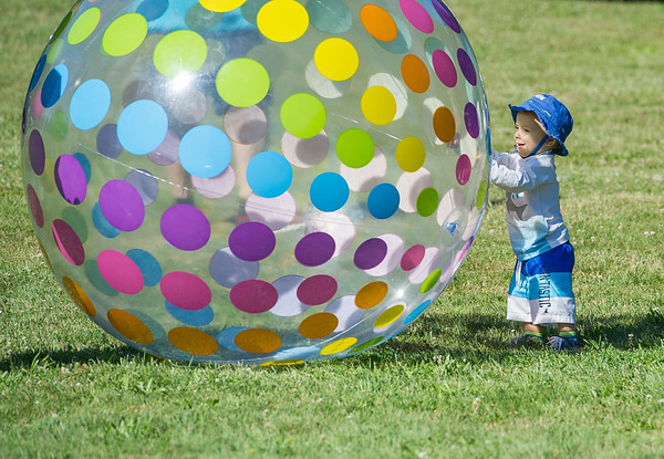 AMANDA SABGA/Staff photo<br /> <br /> Doni Holland, 1, of Peabody plays with a inflatable ball many times his size during the 5th Annual Paddle for Plummer fundraiser for Plummer Youth Promise.<br /> <br /> 7/7/18