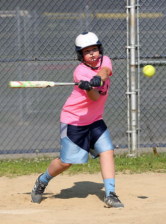 HADLEY GREEN/Staff photo<br /> Lizzy Bettencourt hits at the Peabody Little League softball practice at Cy Tenney Park. <br /> <br /> 07/11/2018