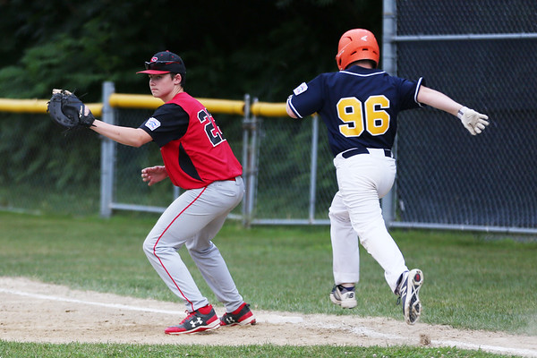 HADLEY GREEN/Staff photo<br /> Salem first baseman Corey Grimes (22) tags Lynnfield's Matt Papagikos (96) out at first at the Lynnfield v. Salem Little League game at Pine Hill in Lynn.<br /> <br /> 07/10/2018
