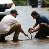 HADLEY GREEN/Staff photo<br /> Workers repair a water main break on the corner of Bartlett Street and Wentzell Ave in Beverly.<br /> <br /> 07/17/2018